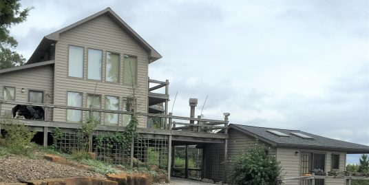 Gorgeous River Views! Log Cabin and 15 Acres Adjoining Gov't Land!