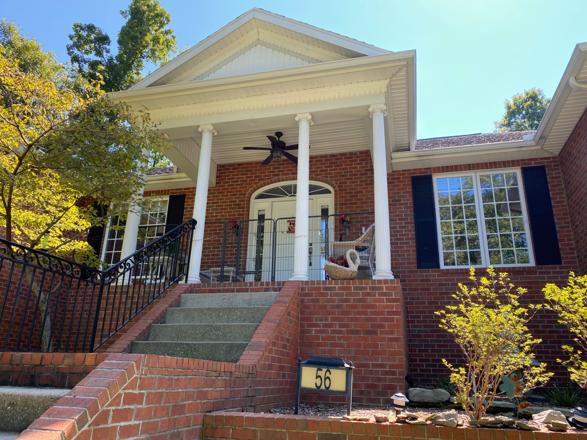 Elegant and impressive brick home with secluded backyard!